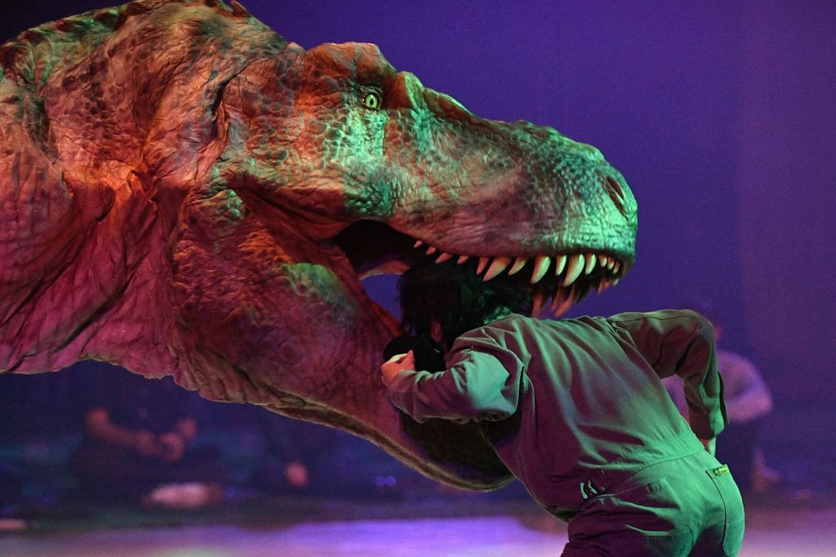 Actors perform in a scene during the 'Dino Safari' show in Tokyo, Japan, April 25, 2018. The Dino Safari show features dinosaurs moving in a realistic way thanks to the Dino-Tronics mechanism that enable the dinosaurs to walk, move their heads and ja