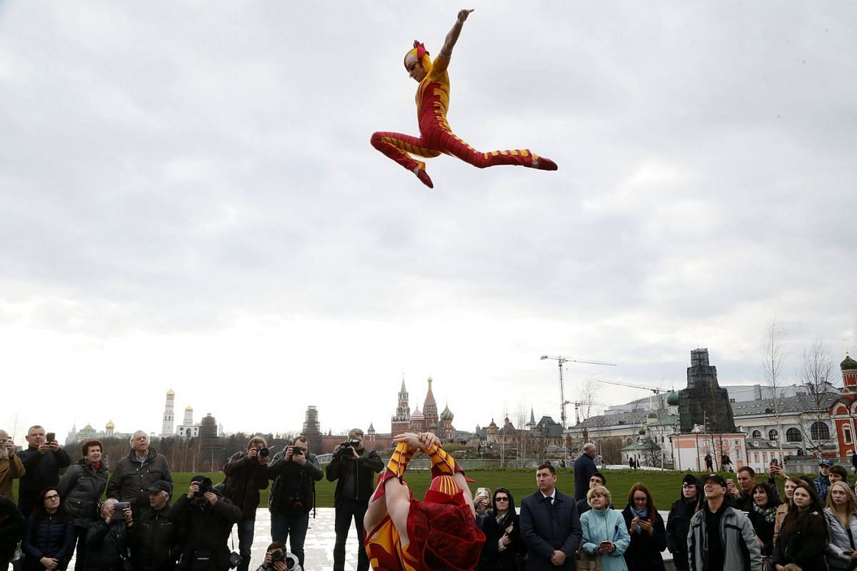 Members of the Cirque du Soleil show 'OVO' perform at the the Zaryadye Landscape Park in central Moscow, Russia, April 25, 2018. The show will be premiered in St. Petersburg on April 28 and will be staged in Moscow from 08 to 20 May. PHOTO: EPA-EFE