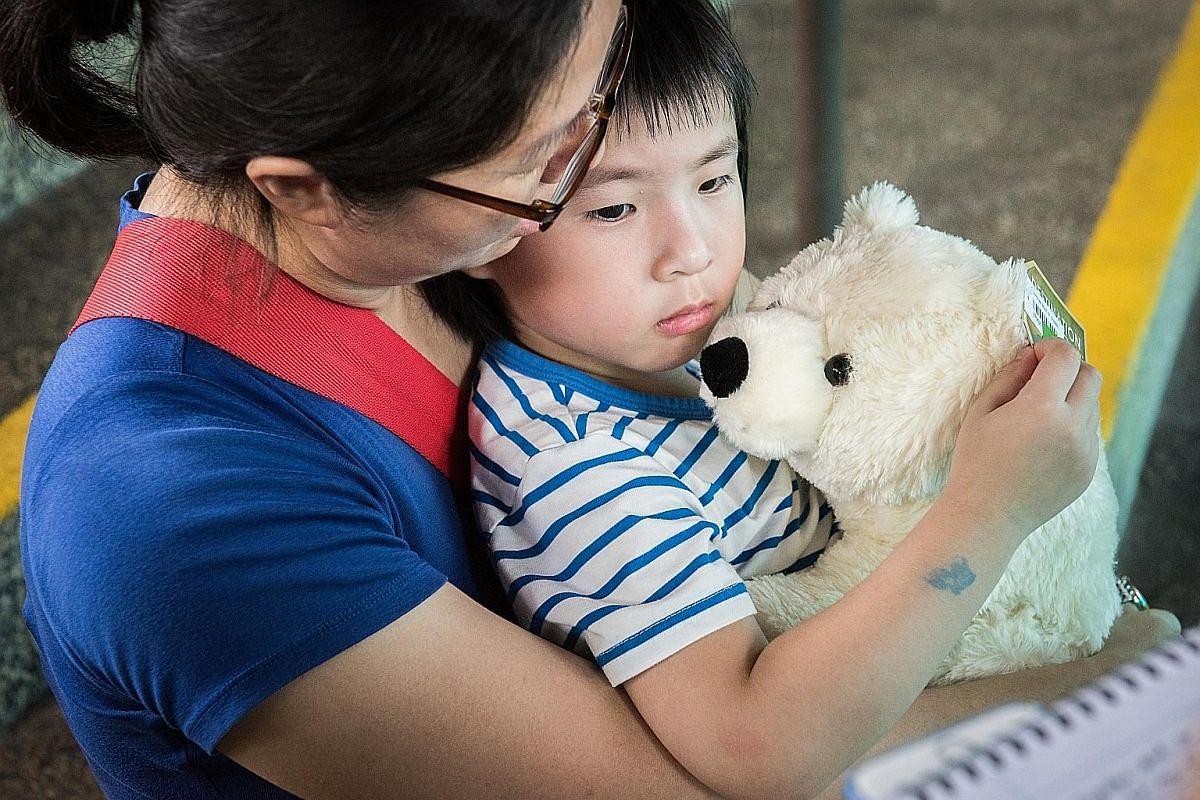 A disappointed Bliss Sen in the arms of her mother Pamela Lee at the zoo after they found out they would not be able to see Inuka yesterday. Ms Lee had taken Bliss to the zoo especially to see the polar bear. Inuka's caregivers past and present gathe