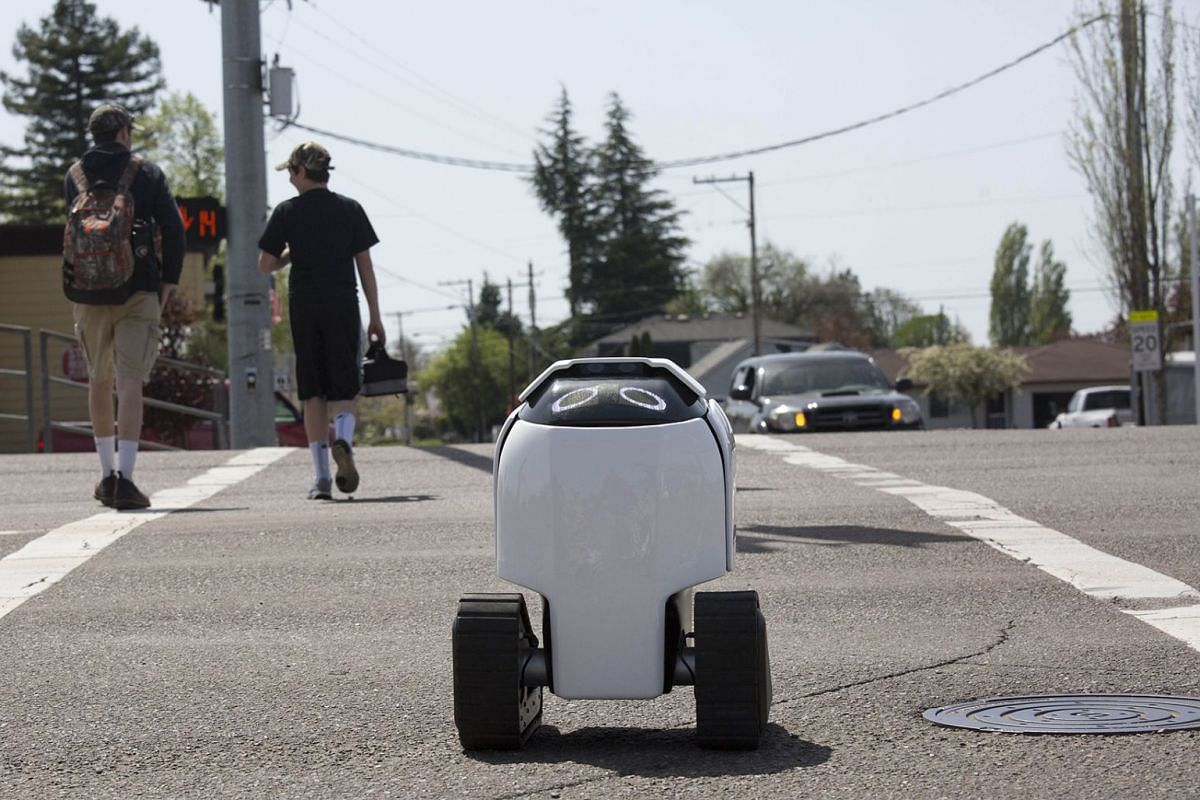 Delivery robot 'DAX' is seen crossing a street at a crosswalk on April 25, 2018 in Philomath, Oregon. Joseph Sullivan, the inventor of DAX is a native of the small town. He says he plans to deploy 30 DAX-like robots to perform various delivery tasks