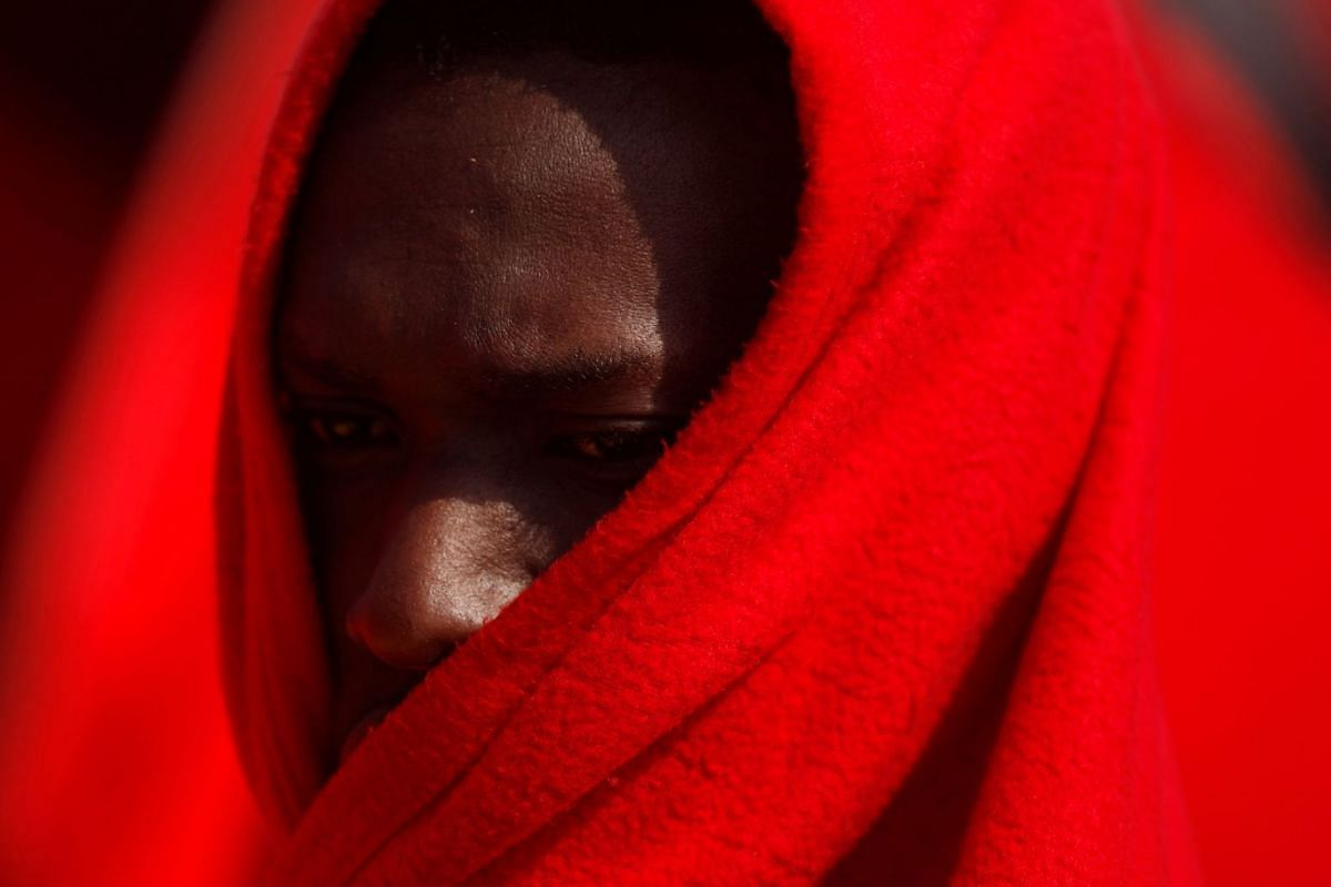 A migrant, part of a group intercepted aboard two dinghies off the coast in the Mediterranean Sea, rests on a rescue boat upon arrival at the port of Malaga, Spain April 26, 2018. PHOTO: REUTERS