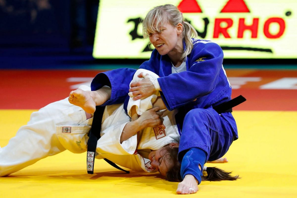 Serbia's Milica Nikolic (bottom) competes against Hungaria's Eva Csernoviczki during their women's under 48kg weight category in the European Judo Championships in the Israeli coastal city of Tel Aviv on April 26, 2018. PHOTO: AFP