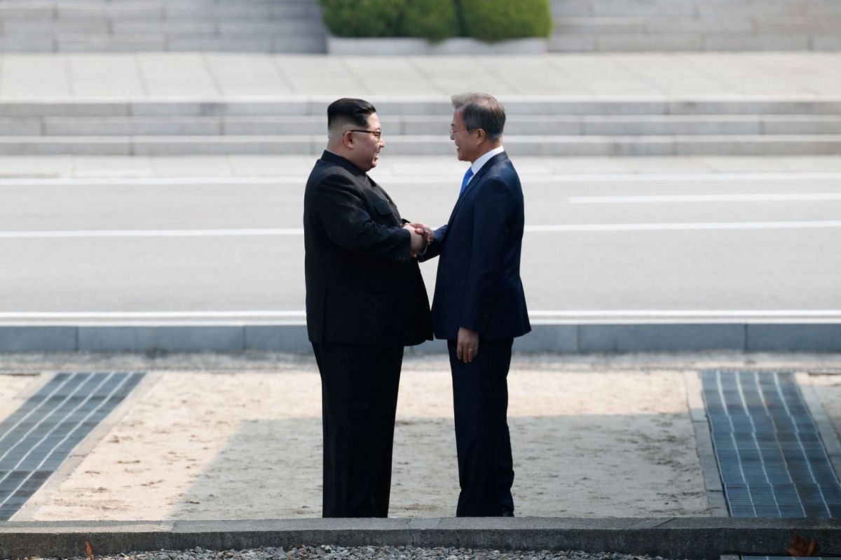 South Korean President Moon Jae In and North Korean leader Kim Jong Un meet in the truce village of Panmunjom inside the demilitarised zone separating the two Koreas on April 27, 2018.