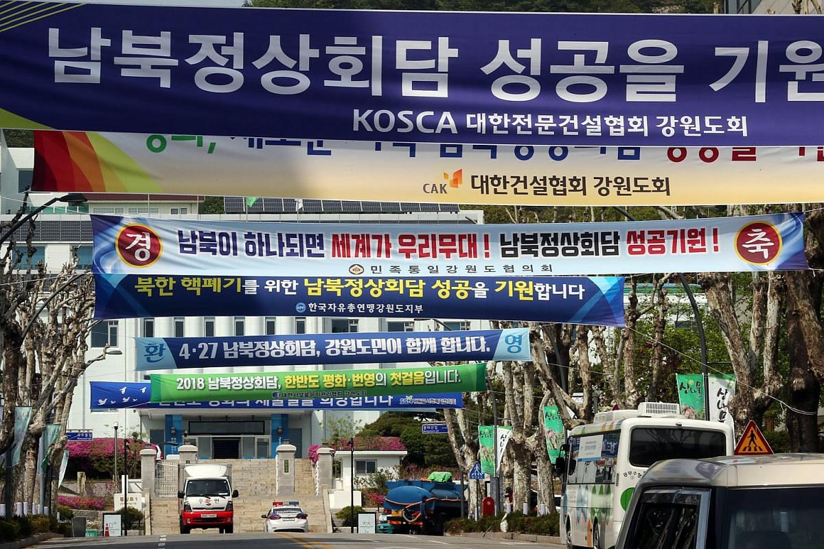 Banners carrying phrases praying for the success of the upcoming inter-Korean summit talks hang over the road in front of the city hall of Chuncheon, South Korea on April 26, 2018.