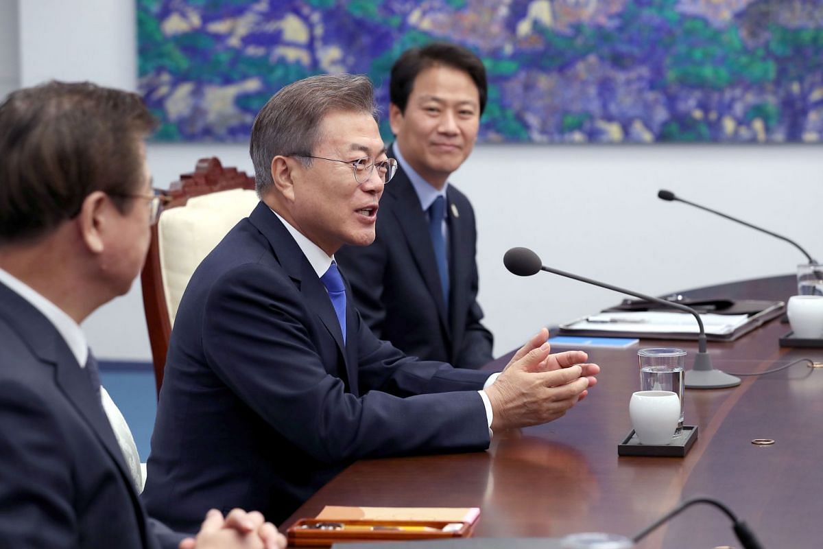 South Korea's President Moon Jae-in (centre) speaks with North Korea's leader Kim Jong Un (unseen) during the Inter-Korean summit in the Peace House building on the southern side of the truce village of Panmunjom on April 27, 2018.