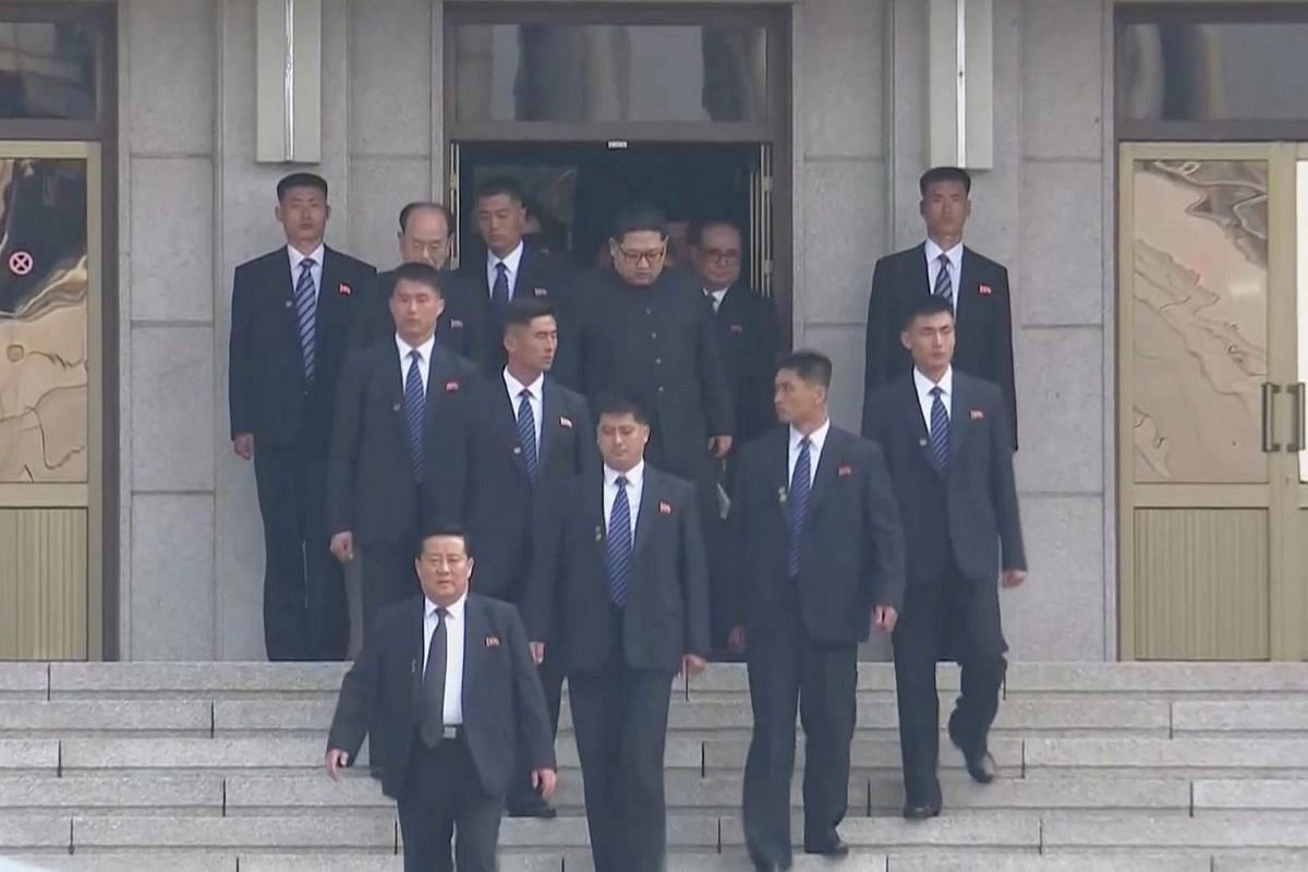 North Korean leader Kim Jong Un (centre) arrives for the inter-Korean summit at the truce village of Panmunjom, South Korea on April 27, 2018.
