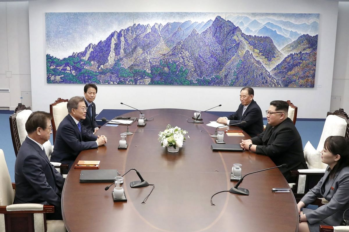 South Korean President Moon Jae In (second from left) and North Korean leader Kim Jong Un (second from right) hold talks at the Peace House of the truce village of Panmunjom, South Korea, on April 27, 2018.