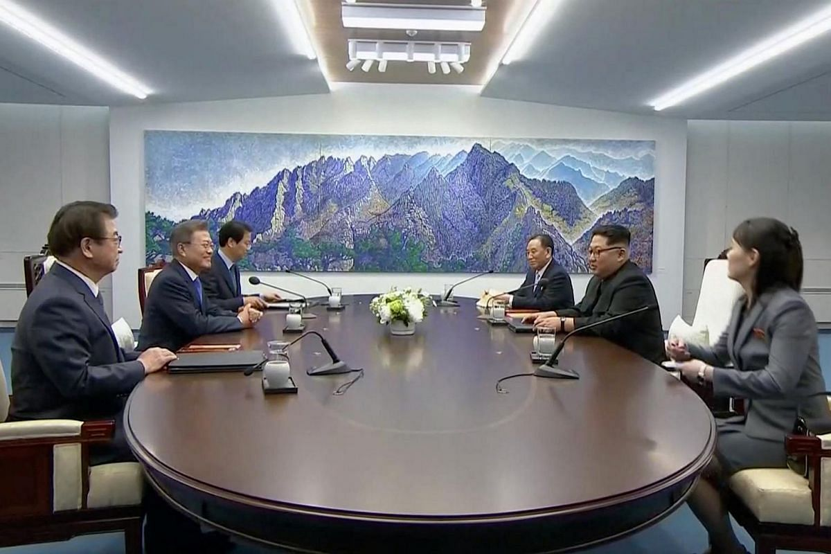 South Korean President Moon Jae In (second from left) and North Korean leader Kim Jong Un (second from right) attend the inter-Korean summit at the truce village of Panmunjom, South Korea on April 27, 2018.