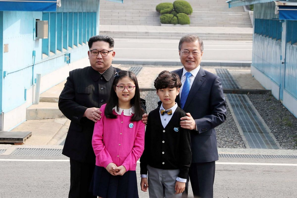 North Korean leader Kim Jong Un (left) and South Korean President Moon Jae In were handed flowers by a South Korean boy and girl, students of an elementary school situated in the South's border town of Daeseong-dong, which is the only South Korean vi