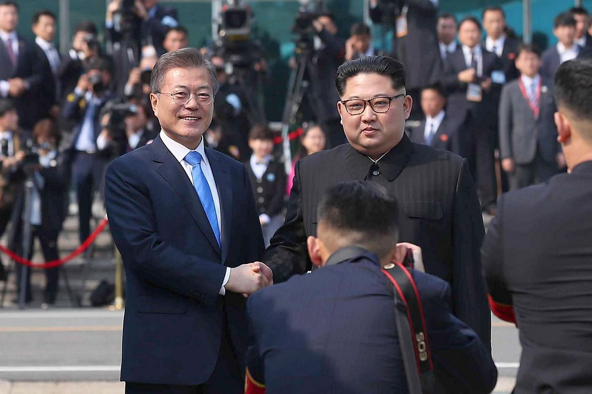 South Korean President Moon Jae In and North Korean leader Kim Jong Un pose for a photograph as they meet in the truce village of Panmunjom inside the demilitarised zone separating the two Koreas on April 27, 2018.