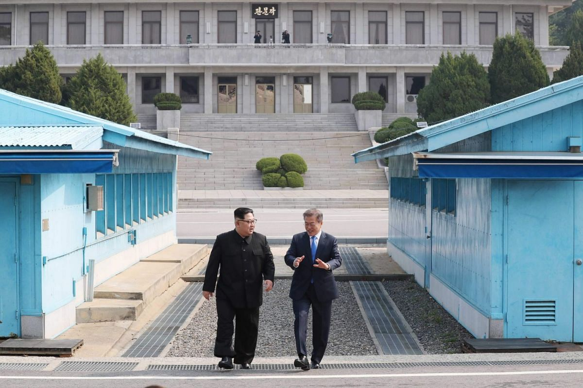 South Korean President Moon Jae In (right) walks with North Korean leader Kim Jong Un in the truce village of Panmunjom inside the demilitarised zone separating the two Koreas on April 27, 2018.