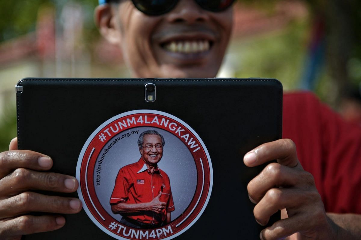A Pakatan Harapan supporter at the Langkawi District and Land Office on Nomination Day in Langkawi's main town, Kuah, on April 28, 2018.