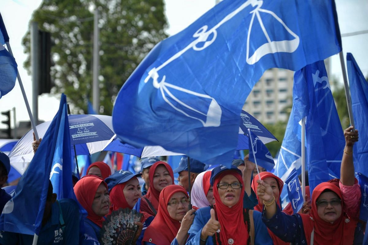 Barisan Nasional supporters at gather at the Langkawi District and Land Office on Nomination Day in Langkawi's main town, Kuah, on April 28, 2018.