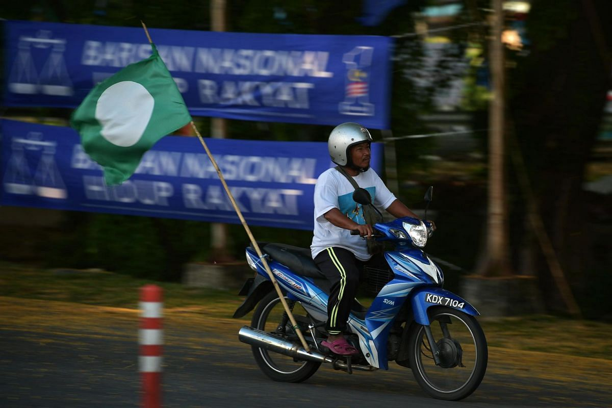 A PAS supporter at the Langkawi District and Land Office on Nomination Day in Langkawi's main town, Kuah, on April 28, 2018.