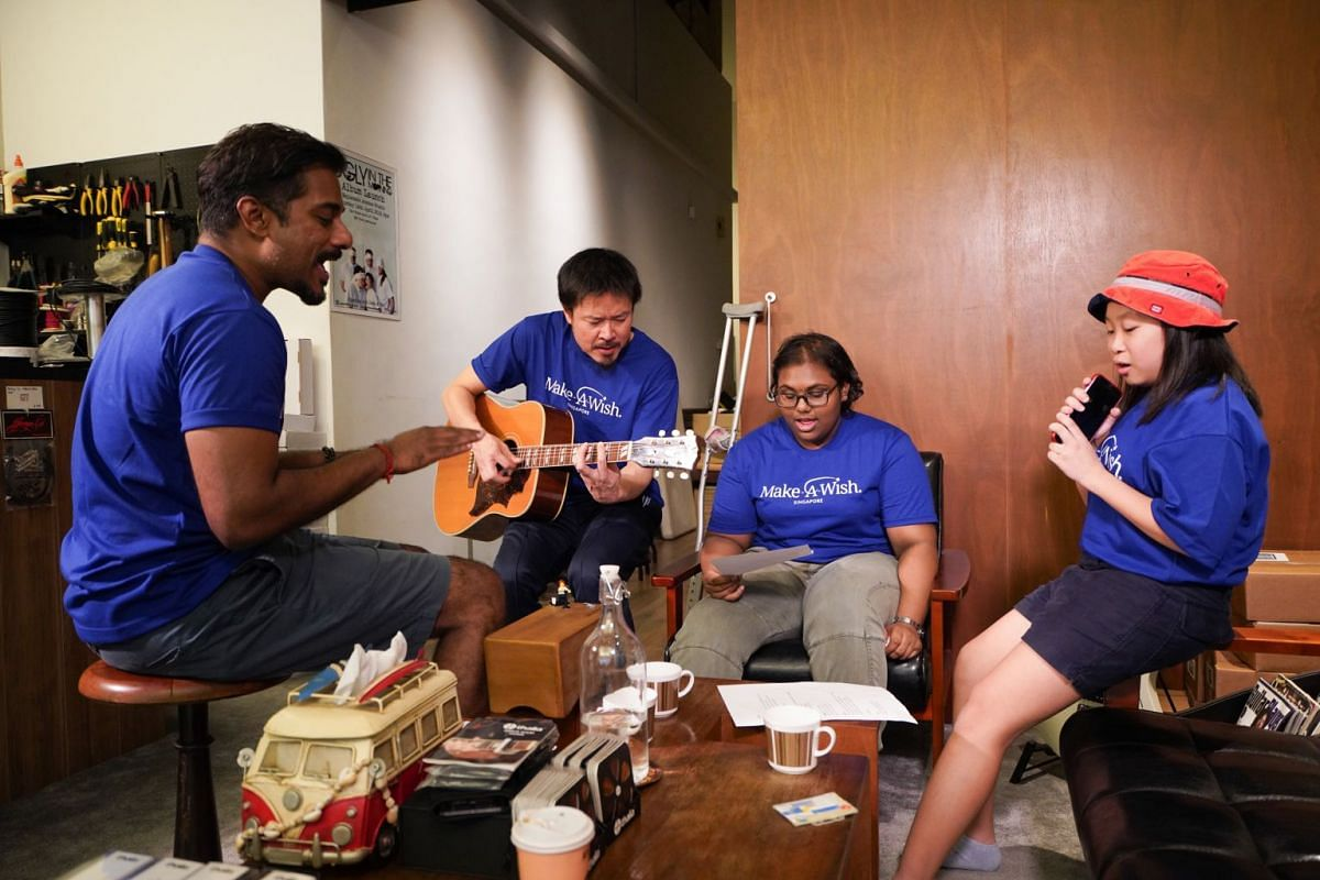 Young singer-musicians Narmada Subramaniam Kumaran (second from right) and Sarah Tan rehearsing with performing duo Jack And Rai.