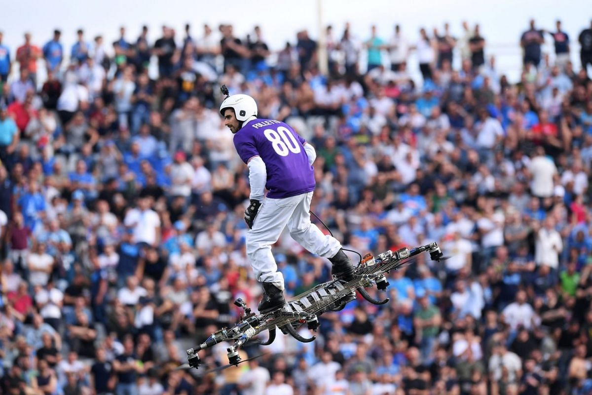 A Fiorentina fan flies on a drone inside the Stadio Artemio Franchi, Florence, Italy, before the Serie A match between Fiorentina and Napoli on April 29, 2018.