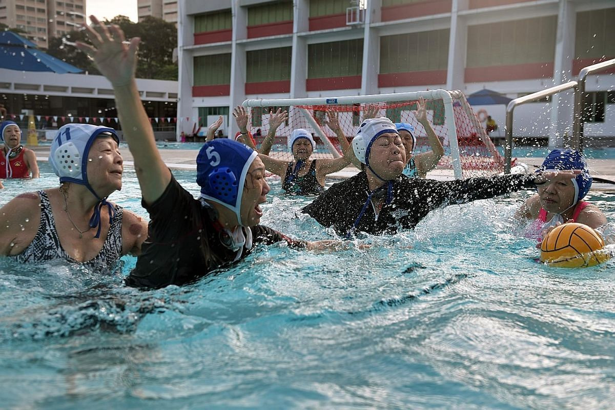 """Top: Lifeguard Teo Chin Lor, 49, helping the Ah Mas to store away the water polo balls. """"I've heard that some of them call me 'auntie killer', but I'm not sure who gave me that name,"""" he said. Left: Madam Chua Li Cheng, pretending to feed Mr Gan, the"""