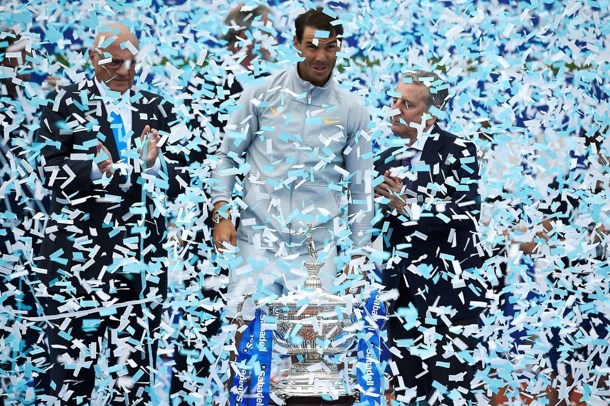 Confetti falls on Rafael Nadal as he celebrates winning the Barcelona Open ATP tournament final in Barcelona on April 29, 2018. The Spanish tennis player has now won 11 Barcelona Open titles.