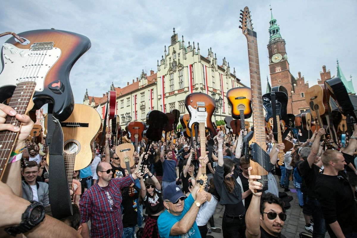 "More than 7411 guitarists play ""Hey Joe"" by Jimi Hendrix to beat the Guitar Guinness World Record at the Market Square in Wroclaw, Poland May 1, 2018."