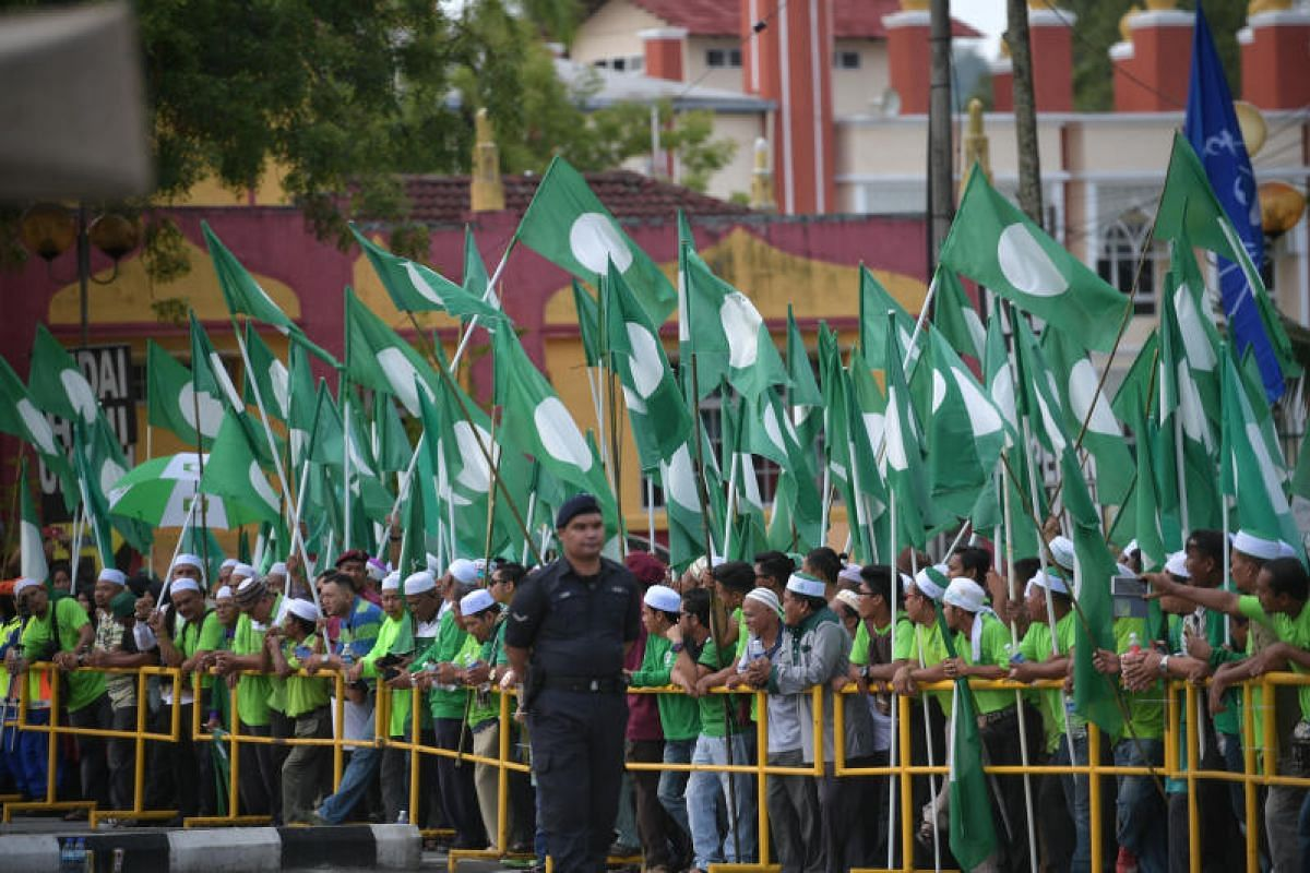 PAS supporters gather at the Langkawi District and Land Office on Nomination Day in Langkawi's main town, Kuah, on April 28. 2018.