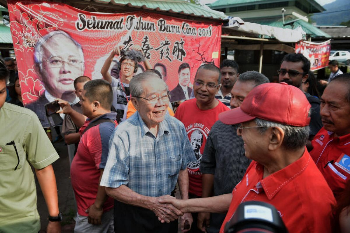 Former Malaysian Prime Minister Tun Mahathir Mohamad meeting residents as he goes on a walkabout at Pasar Kuah in Langkawi, on April 29, 2018.
