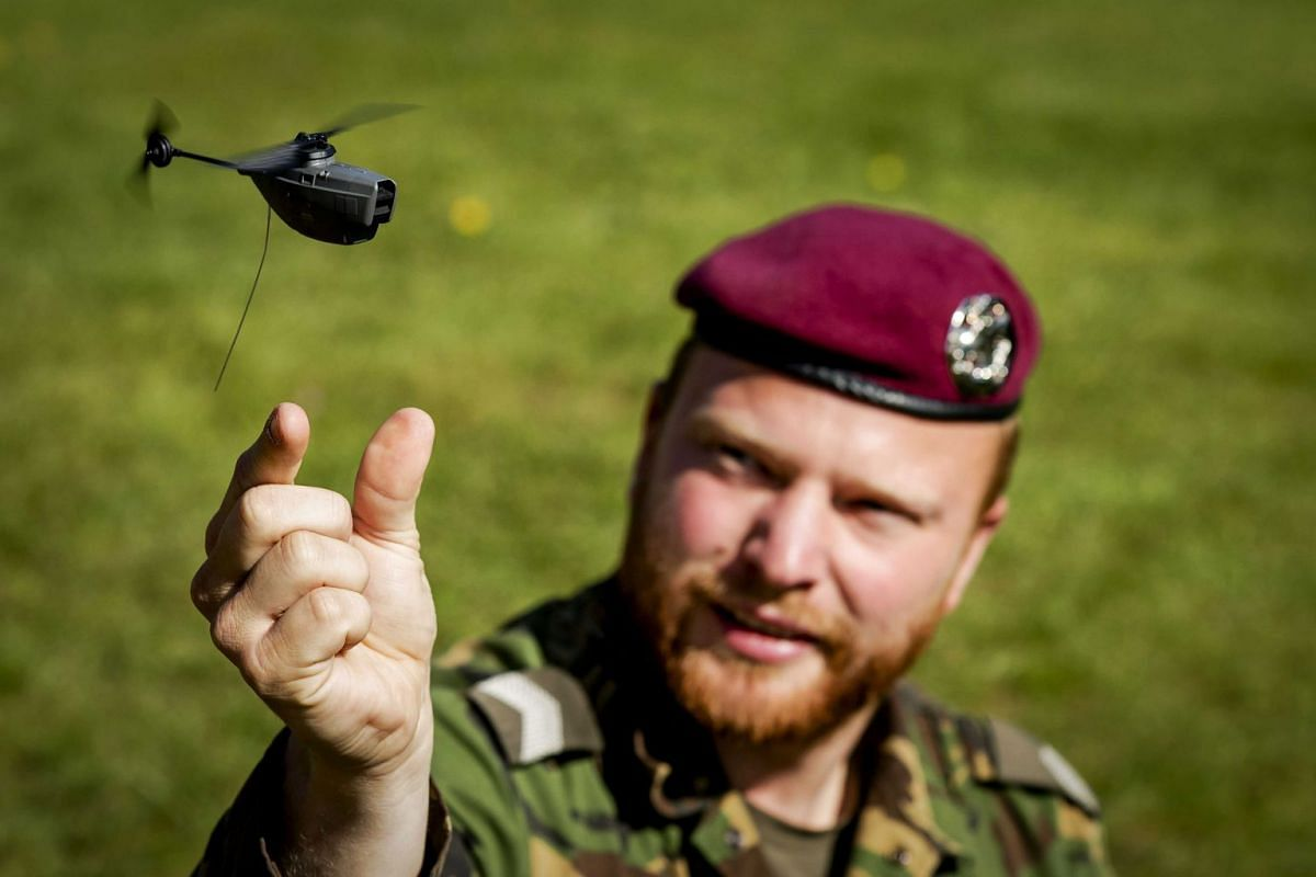 Small Black Hornet drones are seen in a demonstation in Arnhem, The Netherlands, May 2, 2018. The Dutch army is going to buy these tiny drones, with a weight of only 18 grams, for scouting missions.