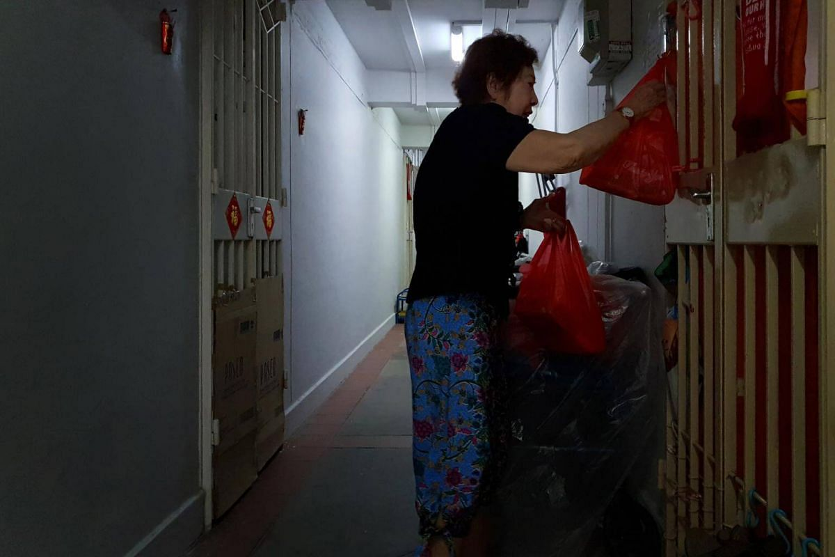 Nancy Leow hangs the food on a hook on the metal gate if the residents' doors are closed.