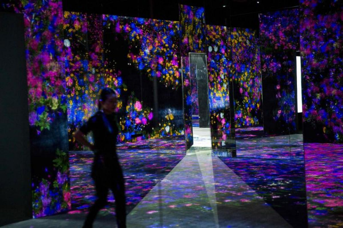 A digital installation flower-filled room at Mori Building Digital Art Museum in Tokyo, on May 1, 2018.