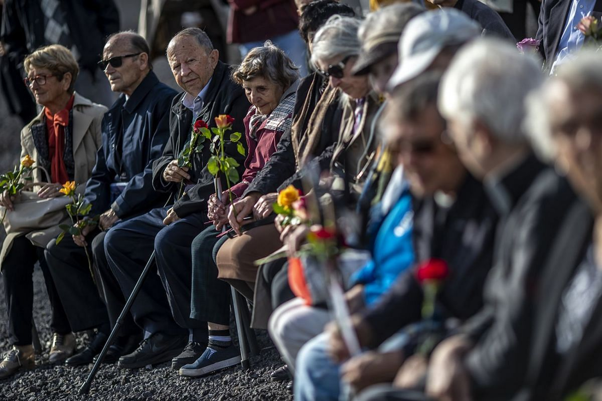 Survivors of the concentration camp Neuengamme near Hamburg, Germany, attend a commemoration of the 73rd anniversary of the liberation of Neuengamme on May 3, 2018.