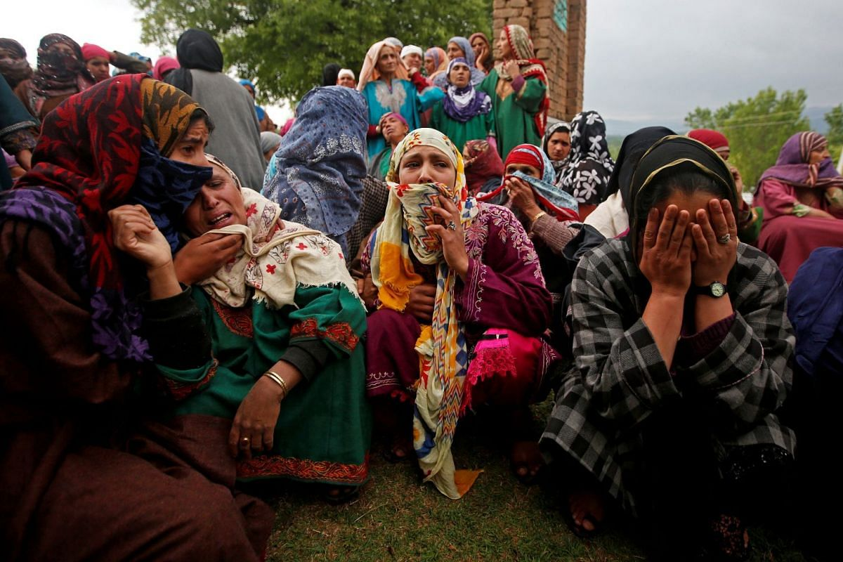 Relatives mourn at the funeral of Umar Kumhar at Pinjora village in Kashmir's Shopian district on May 3, 2018. According to local media, he was killed during clashes with Indian security forces near the site of a gun battle.