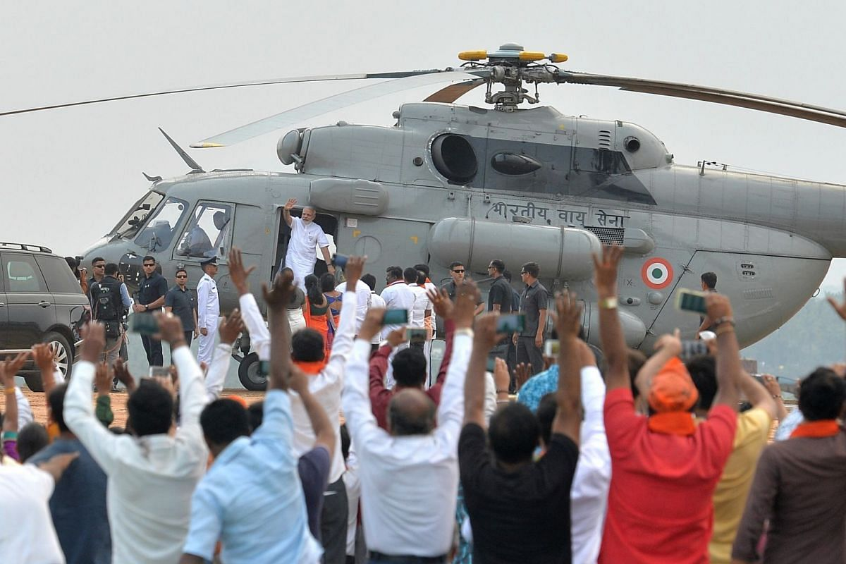 Indian Prime Minister Narendra Modi greets Bharatiya Janata Party (BJP) supporters after landing in an Indian Air Force helicopter at a party election campaign rally in Bangalore, India, on May 3, 2018. The Indian state of Karnataka is going to the