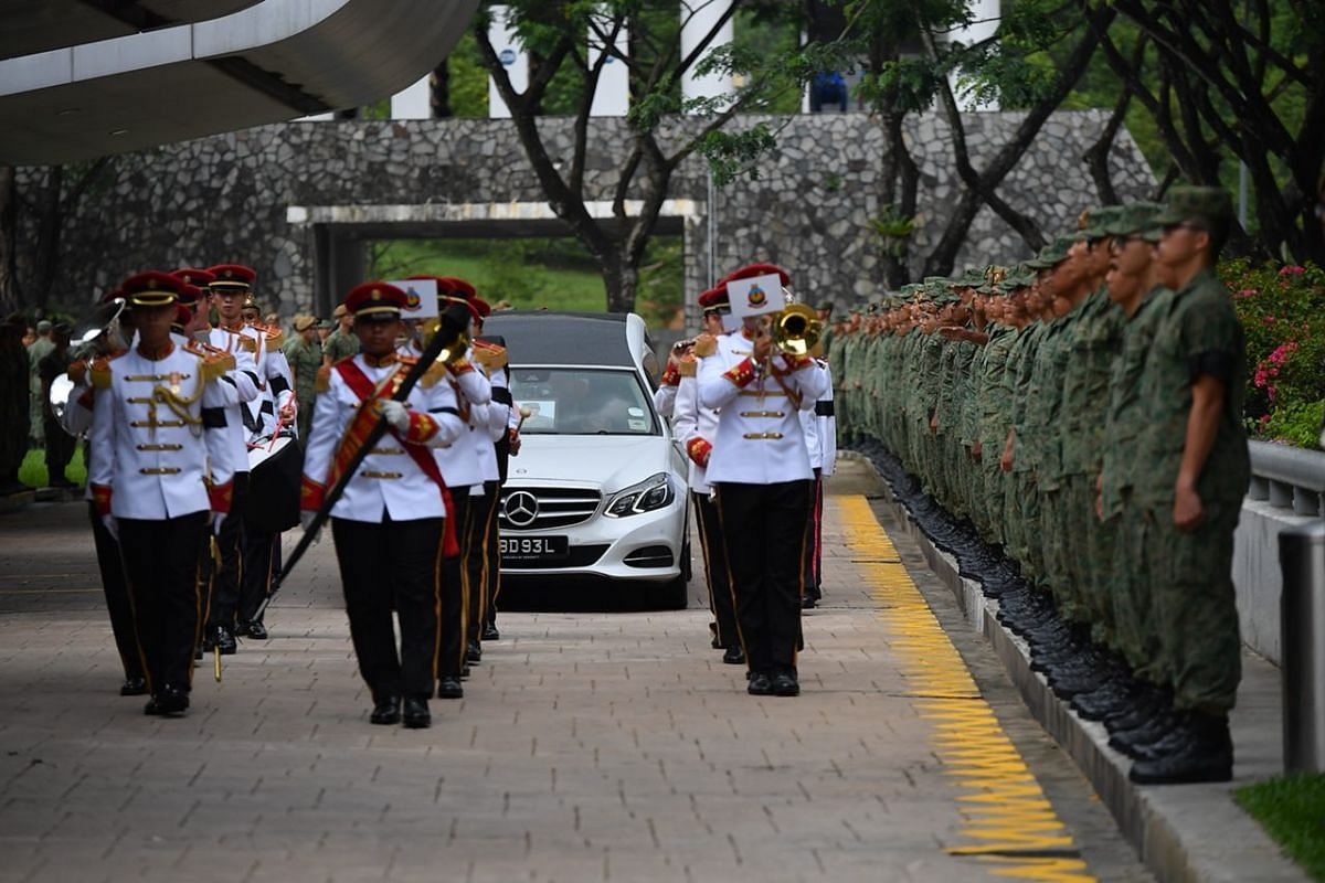 Army personnel bearing the coffin of Corporal First Class Dave Lee Han Xuan, arrive at Mandai Crematorium.
