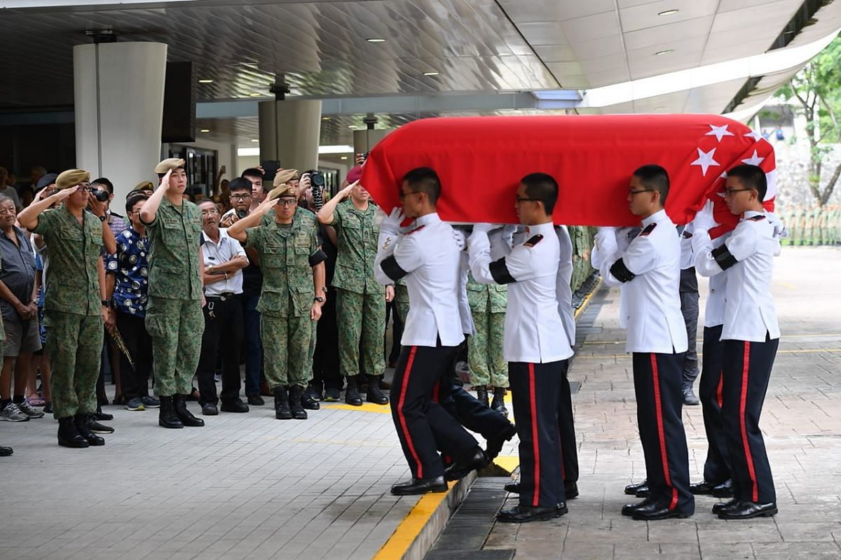 Army personnel bearing the coffin of Corporal First Class Dave Lee Han Xuan arrive at Mandai Crematorium.