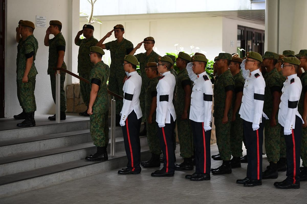 Army personnel salute Corporal First Class Dave Lee Han Xuan at Mandai Crematorium.