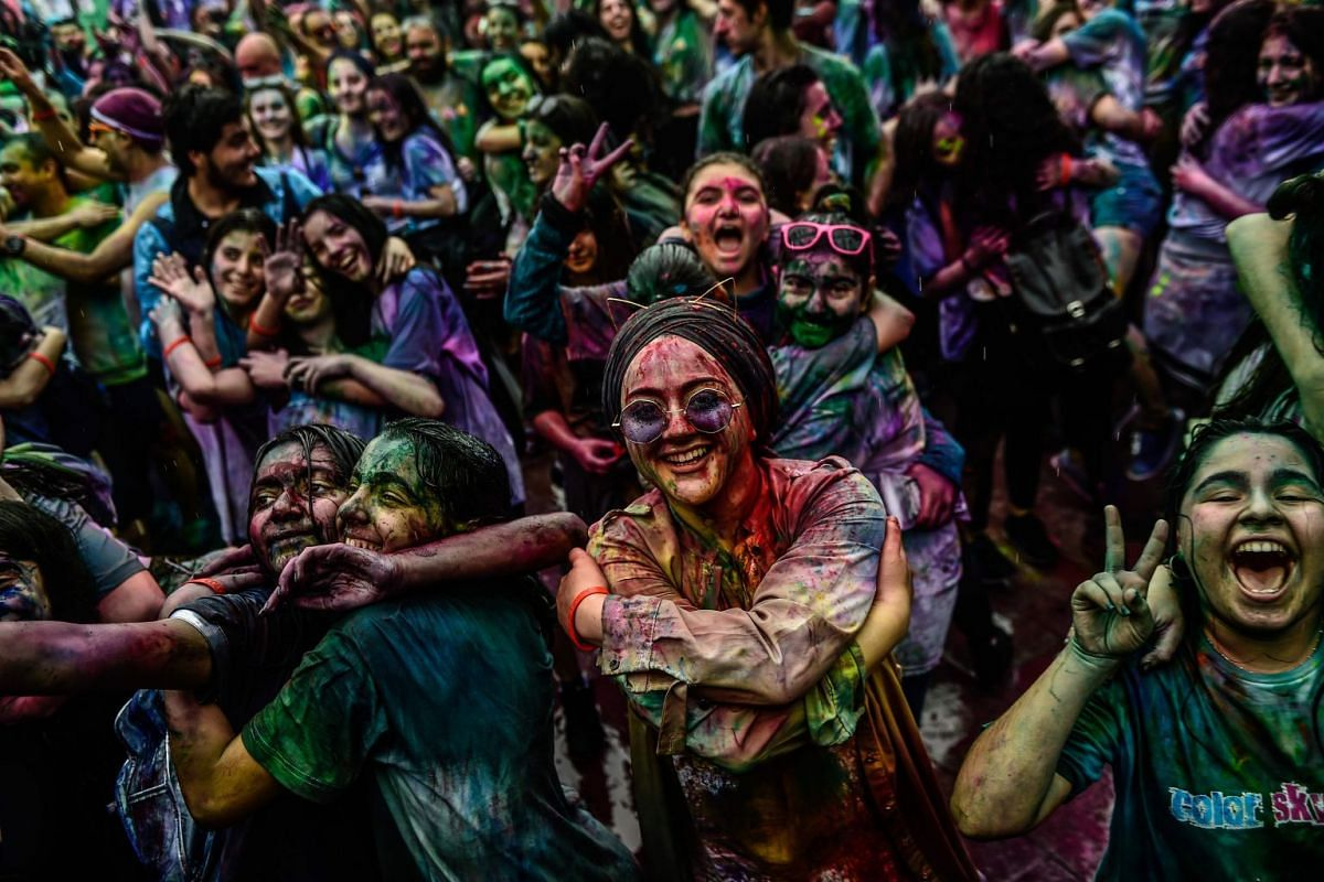 People gesture and dance as they take part in the Color Sky Festival on May 6, 2018 at Kadikoy district, in Istanbul. PHOTO: AFP