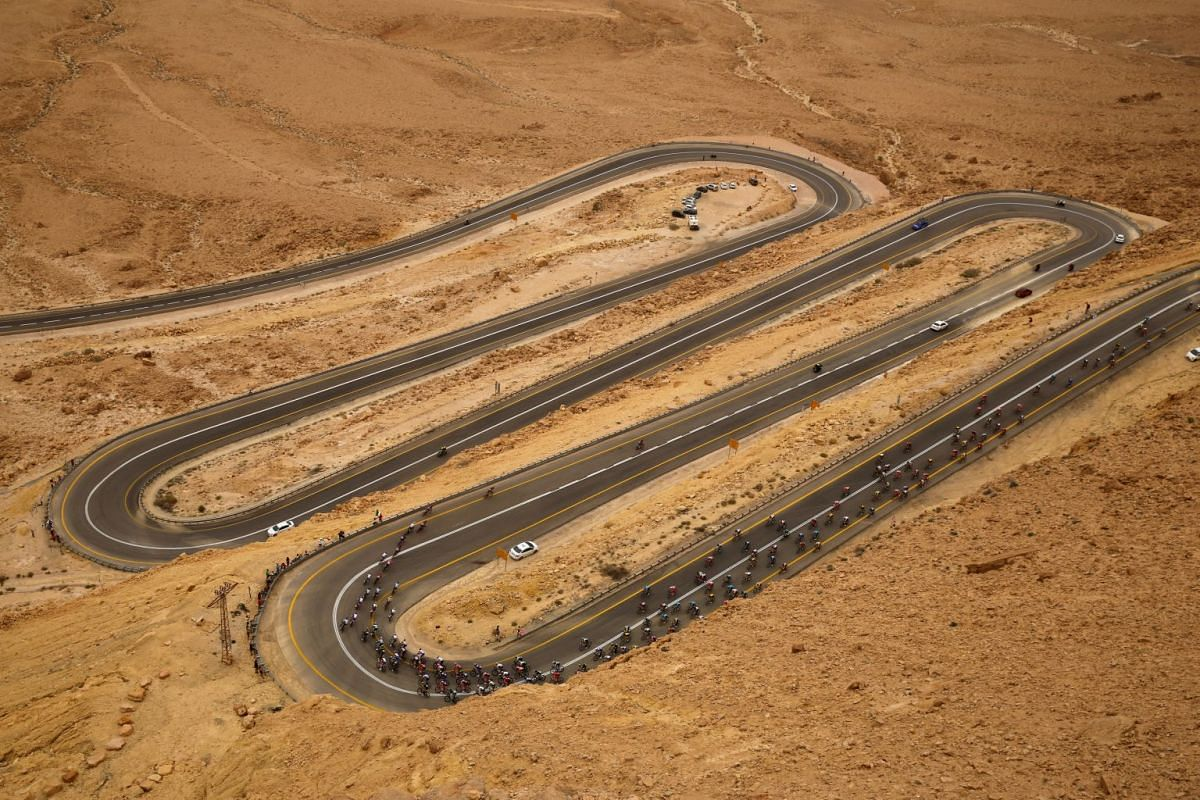 Riders compete on a main road near Mitzpe Ramon during the  101st Giro d'Italia cycling race along a 229-km stretch of road from Beersheba to Eilat, Israel on May 6, 2018. PHOTO: REUTERS