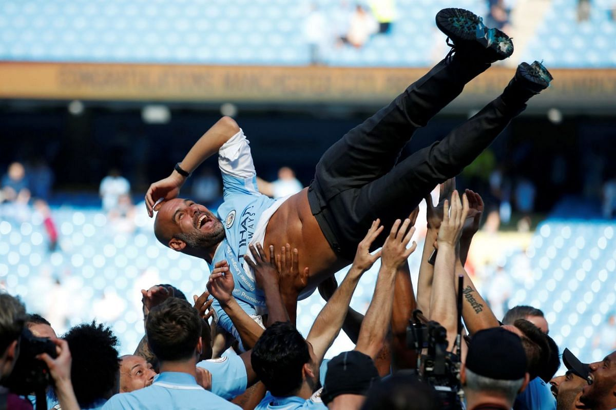 Manchester City manager Pep Guardiola and their players celebrate winning the premier league football title in Etihad Stadium, Manchester, Britain on May 6, 2018. PHOTO: ACTION IMAGES VIA REUTERS