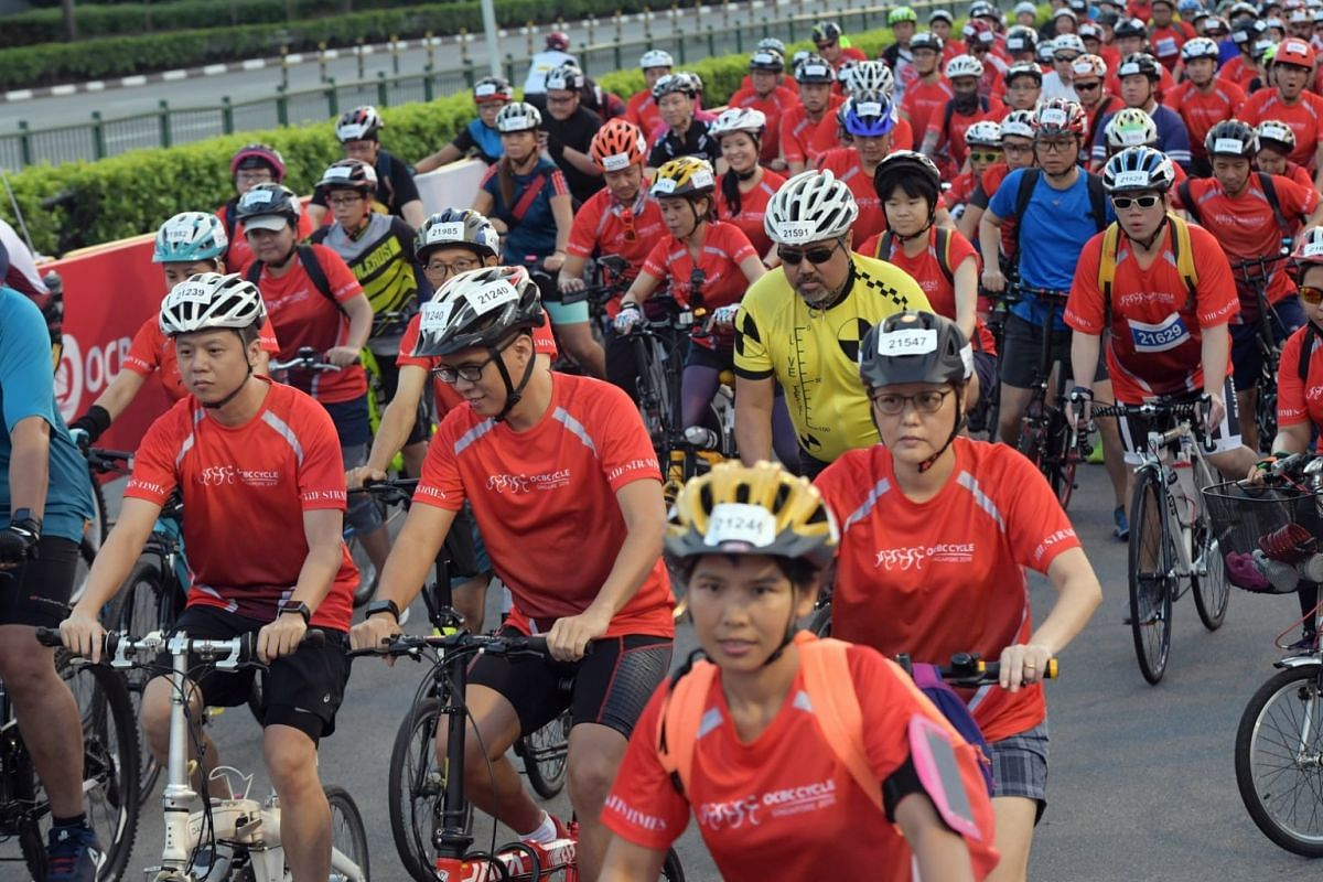 Participants of The Straits Times Ride, part of OCBC Cycle 2018, near the Singapore Sports Hub.