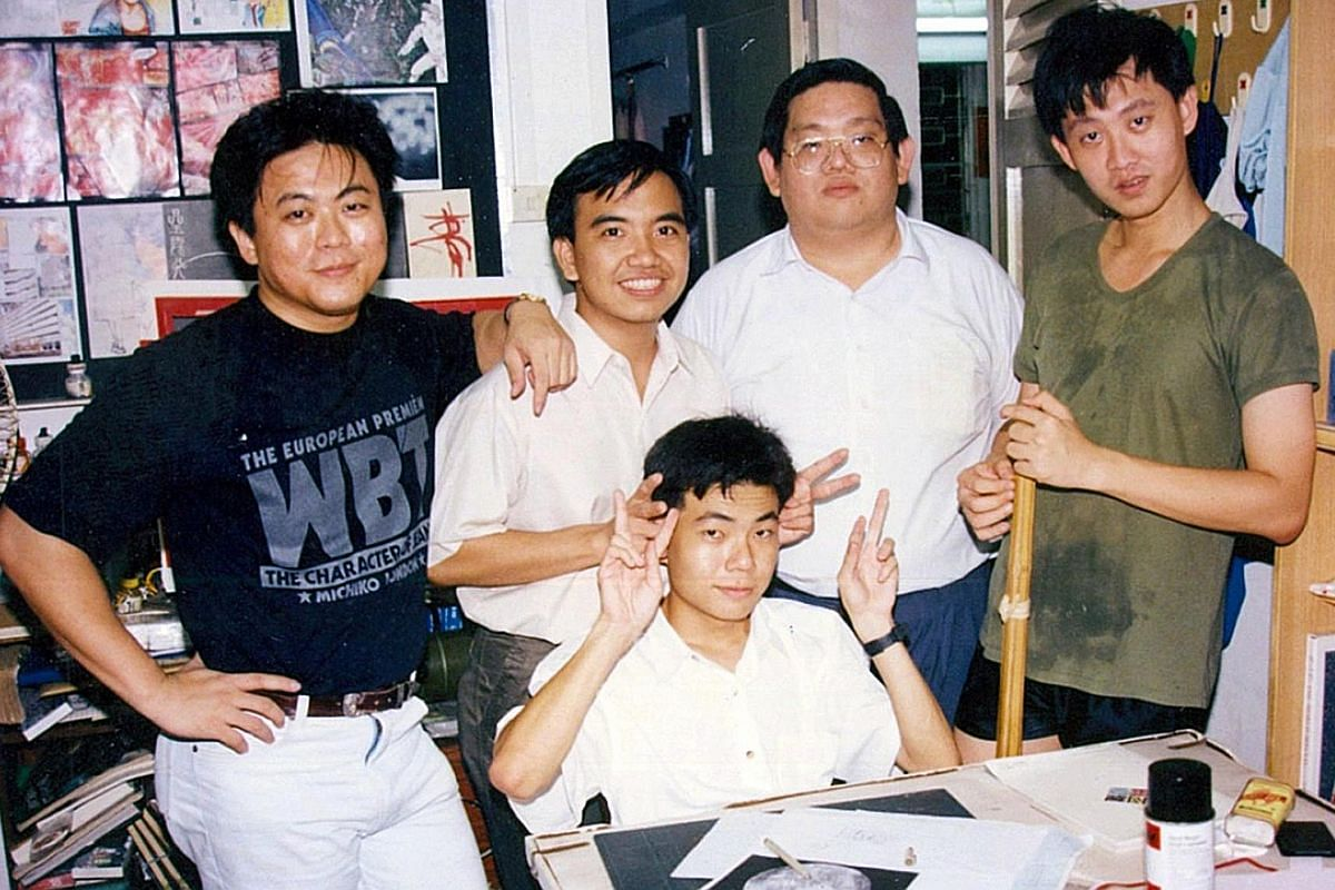 Comic artist Wee Tian Beng (left) with legendary Chinese writer Louis Cha, or Jin Yong, whose Return Of The Condor Heroes he illustrated in the late 1990s, at Cha's house. Wee (right), in his 20s, with his fellow aspiring comic artists (from left) Ta