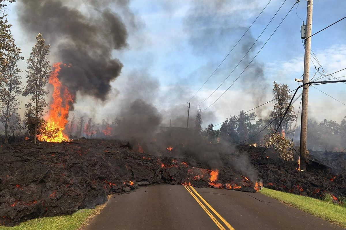 Lava from a fissure slowly advancing to the north-east on Hookapu Street in Leilani Estates, Hawaii, on May 5, 2018.