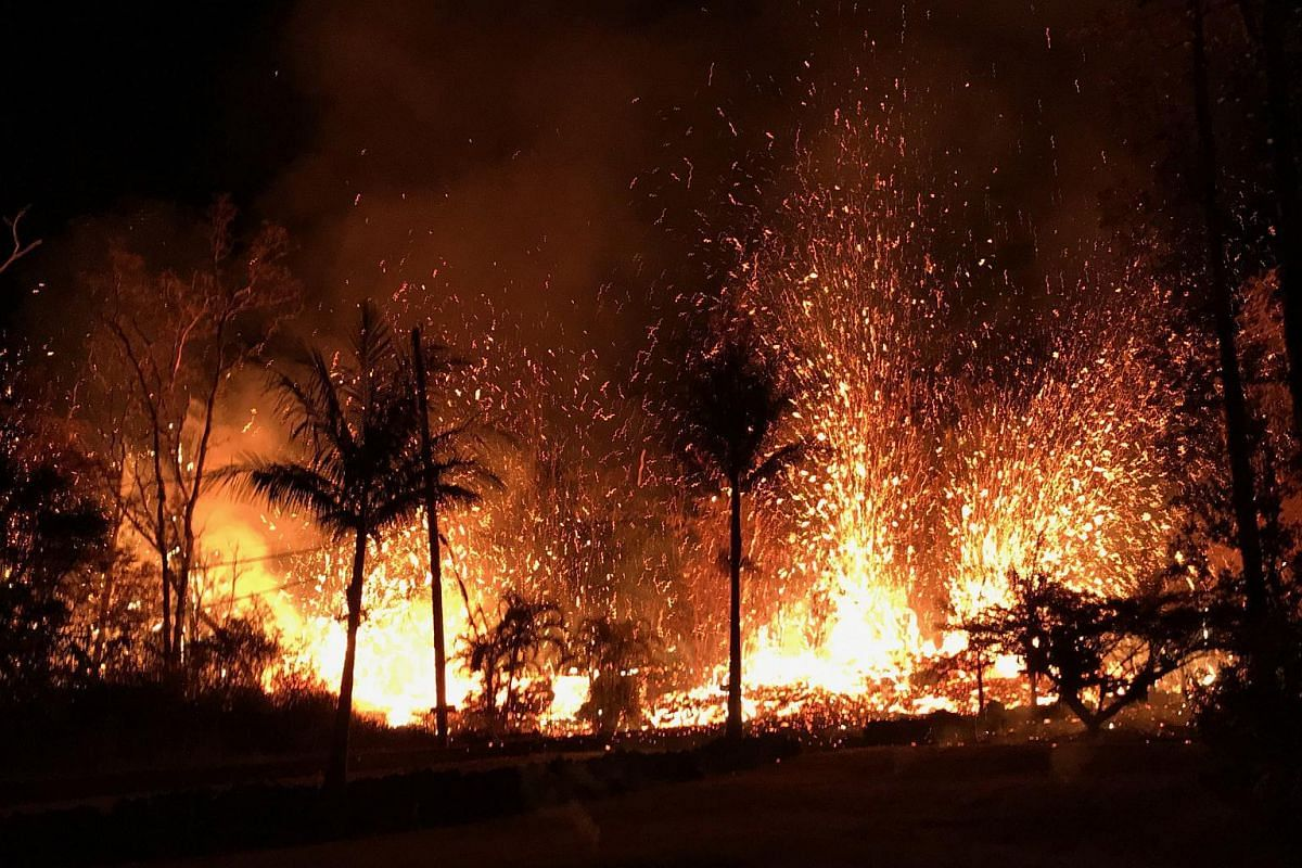 A new fissure erupting from Luana Street, Leilani Estates subdivision on Kīlauea volcano's lower East Rift Zone near Pahoa, Hawaii, on May 5, 2018.