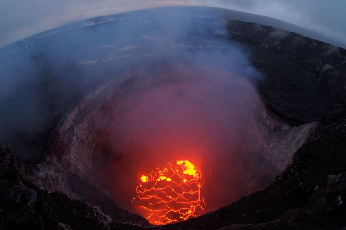 Kilauea volcano's summit lava lake shows a significant drop of roughly 220 metres below the crater rim in this wide angle camera view showing the entire north portion of the Overlook crater in Hawaii, U.S. May 6, 2018. PHOTO: USGS HANDOUT VIA REUTERS