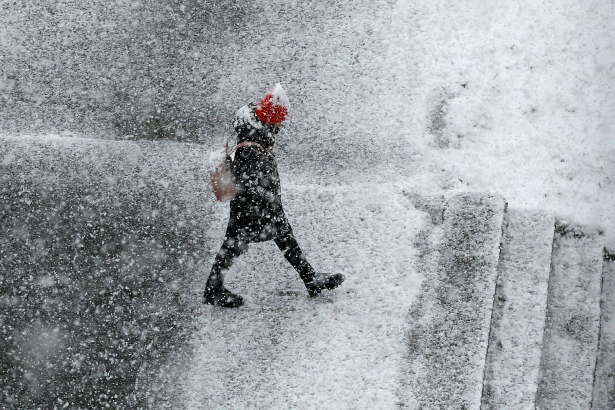 A pedestrian walks during a heavy snowfall in the Siberian town of Divnogorsk, Russia May 7, 2018.  PHOTO: REUTERS