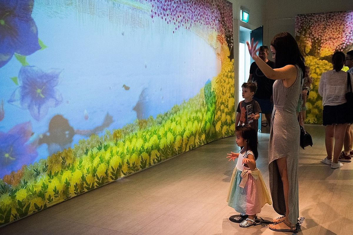 Visitors are invited to jump up and down or wave their hands before Japanese artist Mayuko Kanazawa's Utsuroi Iroha, where one's actions affect animated paintings representing the four seasons.