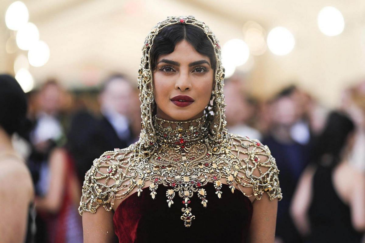 Actress Priyanka Chopra looks ready for battle in her bejewelled coif and capelet.