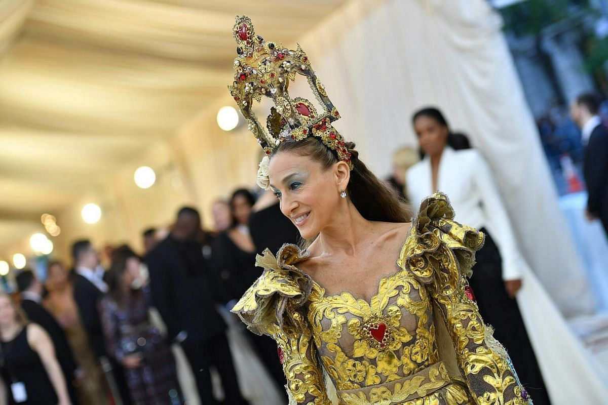 We're worried actress Sarah Jessica Parker might suffer from neck strain with that embellished reliquary on her head.