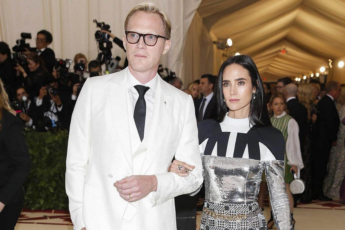 Celebrity couple actors Paul Bettany and Jennifer Connelly arrive at the Met. Connelly's dress looks stitched from three separate outfits. And that gold chain belt? No, just no.