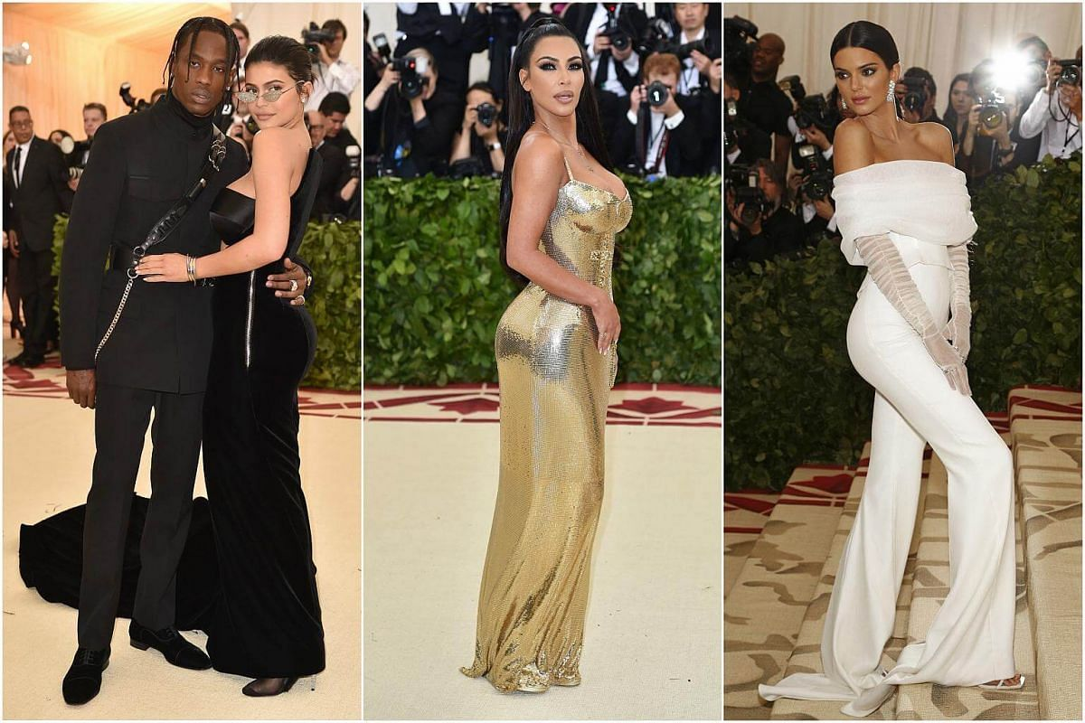 Black, gold and white: The Kardashian family show up with different accessories. Kylie Jenner has boyfriend Travis Scott in tow, Kim requires nothing more than her booty to show off while Kendall Jenner tries to bring long chiffon gloves back (if onl