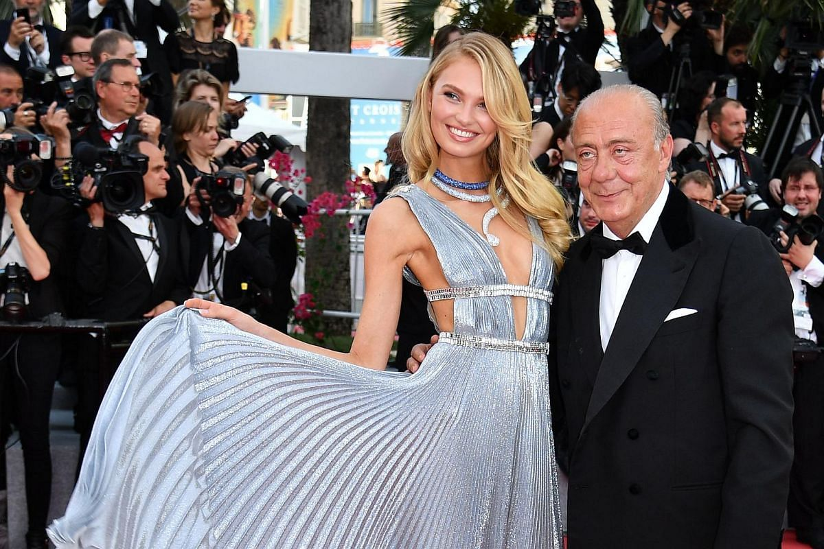 Dutch model Romee Strijd (left) and the president, owner and founder of de GRISOGONO Fawaz Gruosi pose as they arrive on May 8, 2018, for the screening of the film Todos Lo Saben (Everybody Knows) and the opening ceremony of the 71st edition of the C