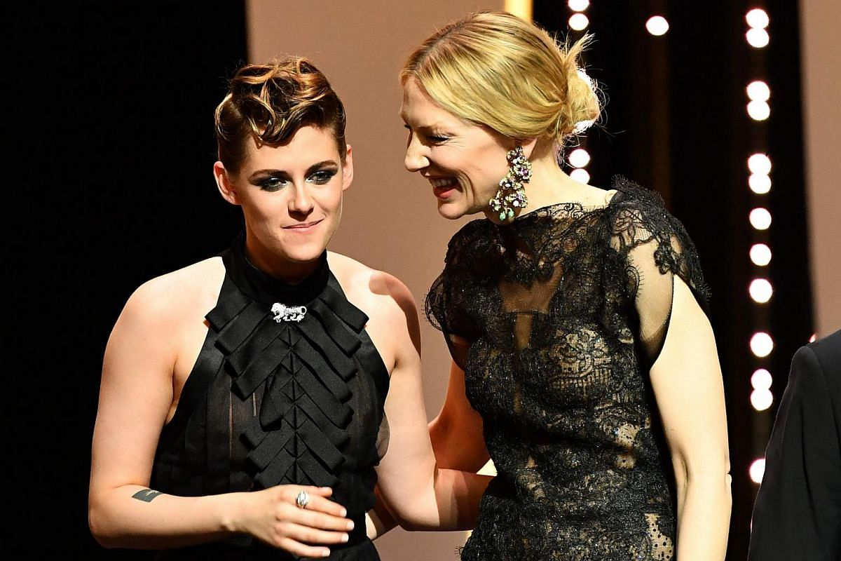 US actress and member of the feature film jury Kristen Stewart (left) and Australian actress and President of the Jury Cate Blanchett pose on stage on May 8, 2018, during the opening ceremony of the 71st edition of the Cannes Film Festival in Canne